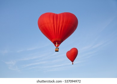 balloons in shape of heart on blue sky background