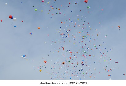 A lot of balloons in the sky.