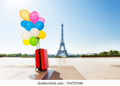 Balloons tied to suitcase left on Paris streets