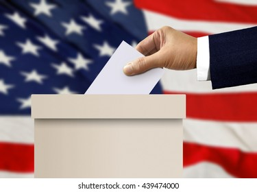 Ballot box with person hand casting a vote