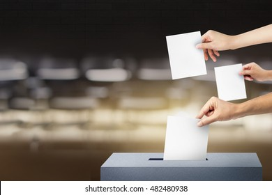 Ballot box with three hands person vote on blank voting slip
