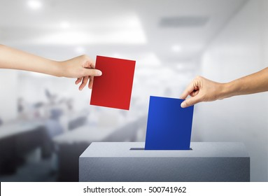 Ballot box with two hands person vote red ballot and blue red ballot at office.