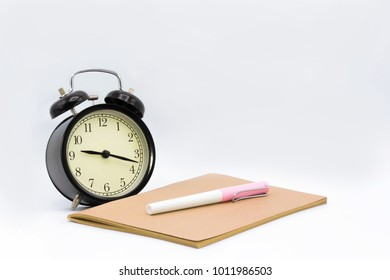 Ballpoint pen, notebook, desk clock with copy space on white background include path for selection, dicut work.