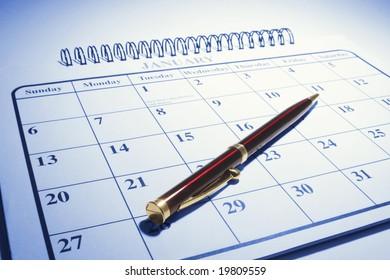 Ballpoint Pen on Calendar in Blue Tone