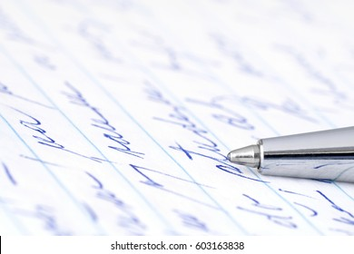 Ballpoint pen on a handwritten sheet of paper.