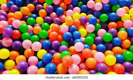 Ballpool with assorted colors of plastic balls at closeup