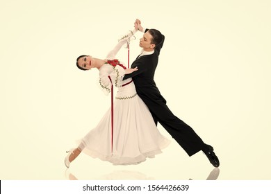 ballroom couple. ballroom dance couple in a dance pose isolated on white background. ballroom sensual proffessional dancers dancing walz, tango, slowfox and quickstep just dance