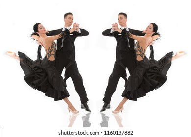 ballroom dance couple in a dance pose isolated on white background. ballroom sensual proffessional dancers dancing walz, tango, slowfox and quickstep ballroom couple dance professional
