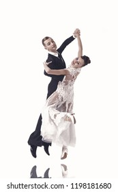 ballroom dance couple in a dance pose isolated on white background. sensual professional dancers dancing walz, tango, slowfox and quickstep