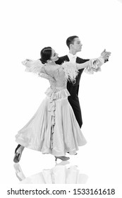 ballroom dance pose. ballroom dance couple in a dance pose isolated on white background. ballroom sensual proffessional dancers dancing walz, tango, slowfox and quickstep just dance