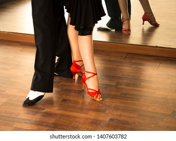 Ballroom dance salsa dancer instructors man and woman couple dancing in shcool rehearsal room