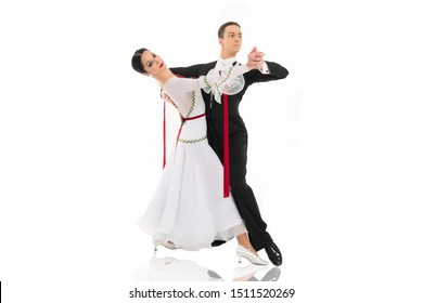 ballroom dancing. ballroom dance couple in a dance pose isolated on white background. ballroom sensual proffessional dancers dancing walz, tango, slowfox and quickstep just dance