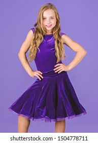 Ballroom fashion. Girl child wear velvet violet dress. Clothes for ballroom dance. Kid fashionable dress looks adorable. Ballroom dancewear fashion concept. Kid dancer satisfied with concert outfit.