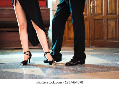 Ballroom latin salsa dancers dancing couple in modern sport dance show in reception hall.