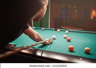 Balls for billiards snooker are triangle, man smashes cue