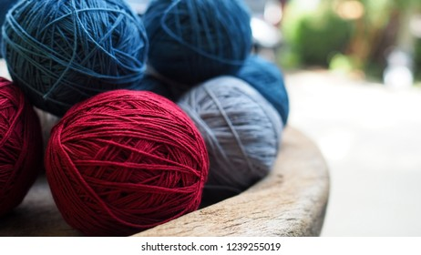 Balls of cotton yarn in a basket, color natural dyes handmade, soft focus and vintage tone for background