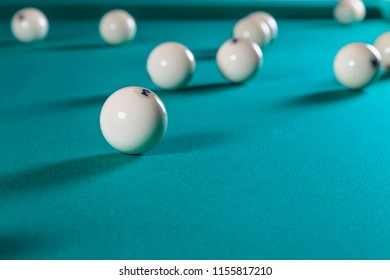 balls for Russian Billiards on a billiard table with a green cloth