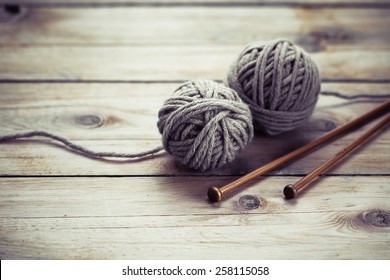 Balls of wool on old wooden background