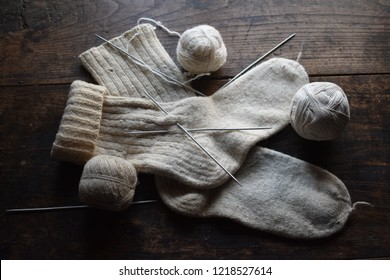 balls of wool and wool socks