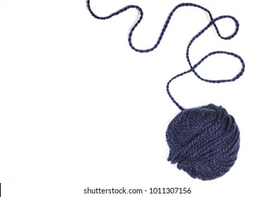 Balls of wool soft yarn with needle for knit on the white wooden background. Copy space for text