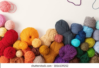 Balls of wool in various colors, on white background