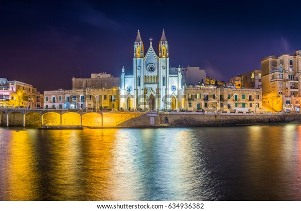 Balluta bay, Malta - Panoramic view of the famous Church of Our Lady of Mount Carmel at Balluta bay by night