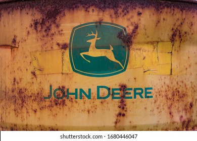 Ballybunion, Ireland - 20th March 2020: Close up on old rusty John Deere barrel in a rural field