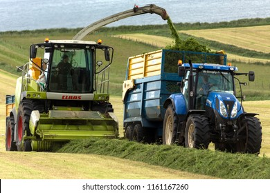 Ballycastle. Northern Ireland. 06.22.16. Agriculture - collecting grass for silage. The crops most often used for ensilage are the ordinary grasses, clovers, alfalfa, vetches, oats, rye and maize.