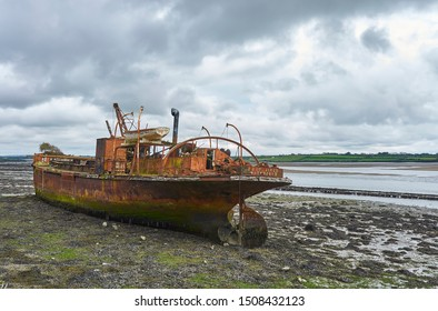 Ballycullane, Eire - 15th October 2012: The Portlairge General Cargo Vessel lying beached in the silt of St Kieran's Quay, Ballycullane in County Wexford, Southern Ireland.