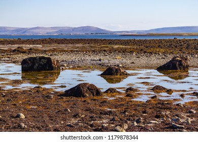 Ballyloughane Beach with mountains in background, Galway, Ireland