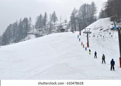 BALME, ITALY - CIRCA FEBRUARY 2017: Tourists skiing in Aosta Valley