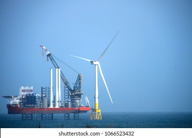 Balmedie, Aberdeenshire / Scotland, United Kingdom - April 11th: The largest wind farm installation vessel in the world and the first turbine installed off the coast of Aberdeen.