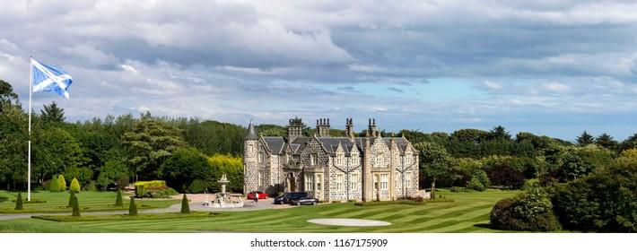 Balmedie, Aberdeenshire / Scotland, United Kingdom - July 8th 2016: Exterior of Hotel Macleod House & Lodge, Trump Aberdeen next to Donald Trump's International Golf Links