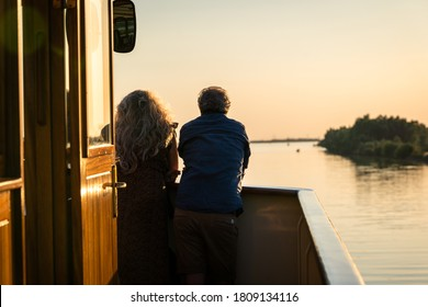 Balmy summer evening with beautiful romantic sunlight from the deck of a river cruise ship