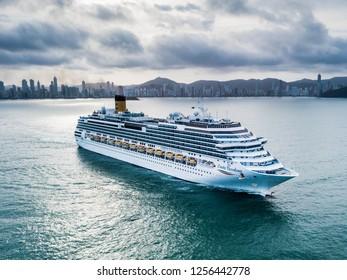 "Balneario Camboriu, Santa Catarina / Brazil - 12 11 2018: Cruise Ship ""Costa Favolosa"" leaves Balneario Camboriu behind after its first call of the 2018/2019 season"