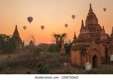 Baloons over temples at sunrise in Bagan, Myanmar