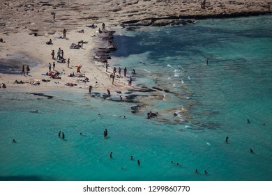 Balos, Greece - August 22, 2011: Balos lagoon on Crete island, Greece. Tourists relax and bath in crystal clear water of Balos beach.