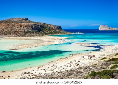 Balos lagoon on Crete island, Greece. Tourists relax and bath in crystal clear water of Balos beach. The most unique natural attraction in Crete.