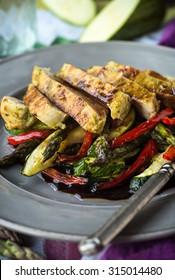 Balsamic glazed chicken slices over grilled vegetables