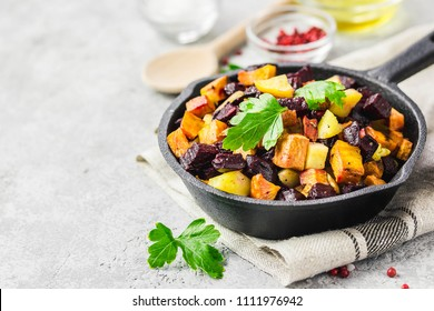 Balsamic roasted vegetables, carrots, sweet potato, pumpkin, beetroot, potato in cast iron skillet. Selective focus, space for text.