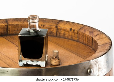 balsamic vinegar bottle isolated with a barrel