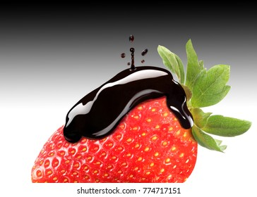 balsamic vinegar dripping on a ripe strawberry