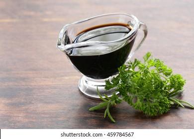 balsamic vinegar in a glass gravy boat