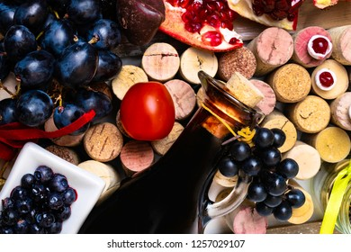 balsamic vinegar in a glass jug with fresh red grapes on wine corks background, rich with resveratrol, flavonoids, antioxidants, pomegranate, cranberry, blueberry, tomatoes