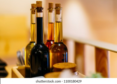 Balsamic Vinegar and Olive Oil Bottles On Restaurant Table
