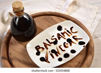 "balsamic vinegar with the words ""Balsamic Vinegar"" on the plate"