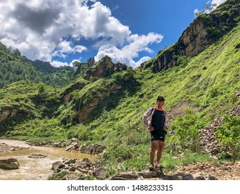 Balthali Kavrepalnchwok/NP- August 19, 2019 : Balthali is one of the best tourist area on a Kavre district. took some photographs of gorgeous mountain with boy.