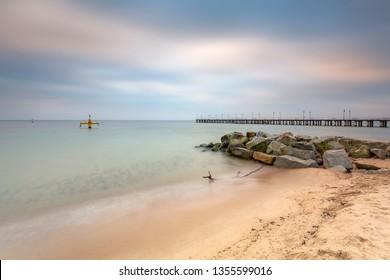 Baltic sea beach in Gdynia Orlowo at dawn, Poland