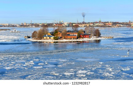 Baltic Sea with ice floes on background of Helsinki on sunny day. Finland