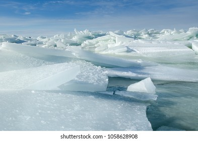 Baltic Sea on wintertime with broken ice cracks. Large pieces of floating ice driven into the seaside. Pack Ice builds up the icebergs.